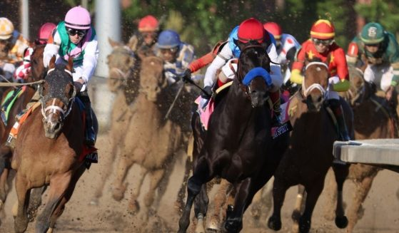 Medina Spirit leads the field on the way to victory in the May 1 Kentucky Derby.