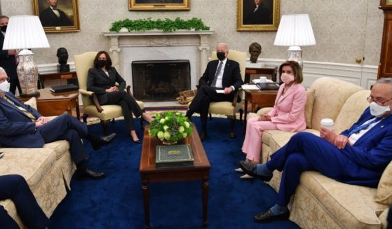 President Joe Biden, center, meets Wednesday in the Oval Office with Senate Minority Leader Mitch McConnell, left, Vice President Kamala Harris, House Speaker Nancy Pelosi and Senate Majority Leader Chuck Schumer. House Minority Leader Kevin McCarthy, not pictured, was seated next to McConnell.