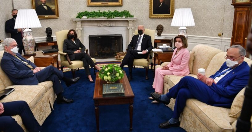 President Joe Biden, center, meets Wednesday in the Oval Office with Senate Minority Leader Mitch McConnell, left, Vice President Kamala Harris, House Speaker Nancy Pelosi andSenate Majority Leader Chuck Schumer. House Minority Leader Kevin McCarthy, not pictured, was seated next to McConnell.