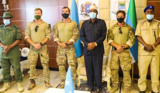 Ahmed Madobe, president of Jubaland, a federal member state within Somalia, poses with uniformed American soldiers in a photo posted on social media on May 4, 2021.