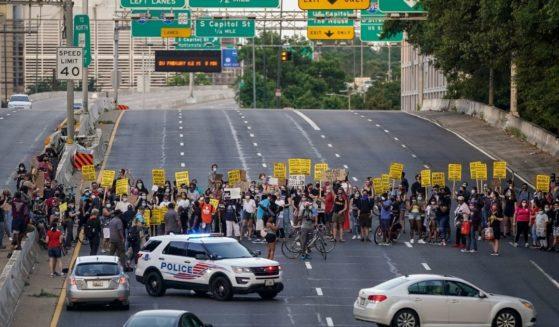 Protesters block traffic on Interstate 395 last June in Washington.