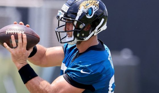 Tim Tebow makes a catch during a Jacksonville Jaguars' practice on May 27, 2021, in Jacksonville, Florida.