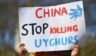 A member of the Uighur community holds a placard as she joins a demonstration to call on the British parliament to vote to recognize the persecution of China's Muslim minority as genocide and crimes against humanity in London on April 22, 2021.