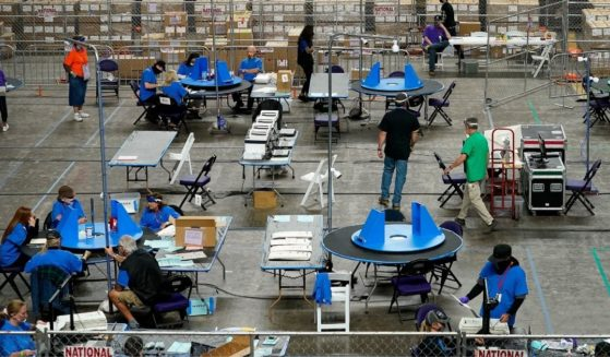 Maricopa County ballots cast in the 2020 general election are examined and recounted by contractors working for Florida-based company, Cyber Ninjas, on Thursday at Veterans Memorial Coliseum in Phoenix.