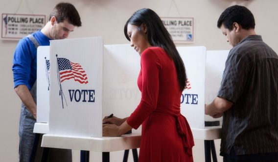 The above stock photo shows voters filling out their ballots.