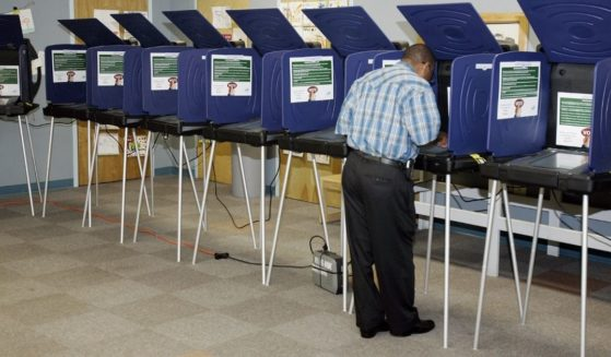 A man casts an early ballot on an electronic machine on Oct. 27, 2006, in Miami.