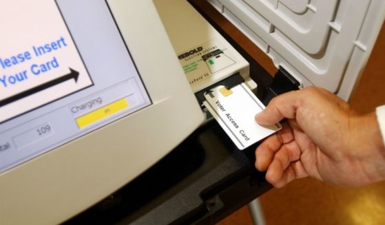 An access card is used to begin the voting process on an AccuVote-TS electronic machine during a demonstration at Leisure World retirement community on Sept. 23, 2002, in Seal Beach, California.