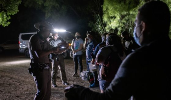Venezuelan immigrants turn themselves in to Texas state troopers after crossing the border with Mexico on May 18, 2021 in Del Rio, Texas.