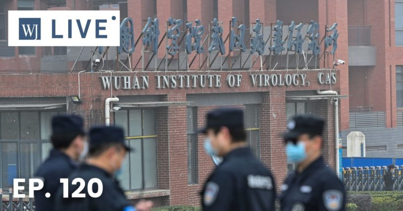 Security personnel stand guard outside the Wuhan Institute of Virology in Wuhan as members of the World Health Organization team investigating the origins of the COVID-19 coronavirus make a visit to the institute in Wuhan in China's central Hubei province on Feb. 3, 2021.