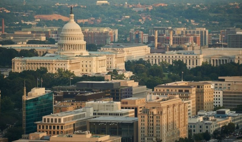 In this stock photo, an aerial view of the U.S. Capitol and the Federal Triangle is depicted in Washington, D.C.