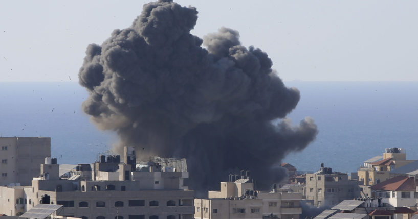 Smoke rises following Israeli airstrikes on a building in Gaza City on Friday.