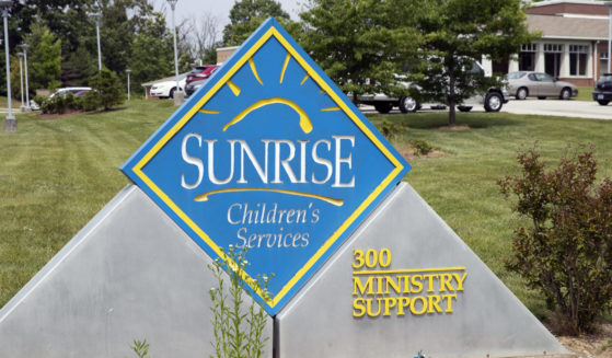 A sign for Sunrise Children's Services sits in front of the agency's Mount Washington, Kentucky, location on Wednesday.