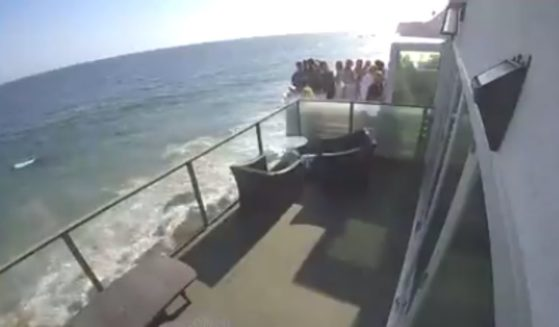 A stunning video shows the moment a packed balcony at a Southern California party collapsed this past weekend and sent more than a dozen people plunging to the rocky ground below.