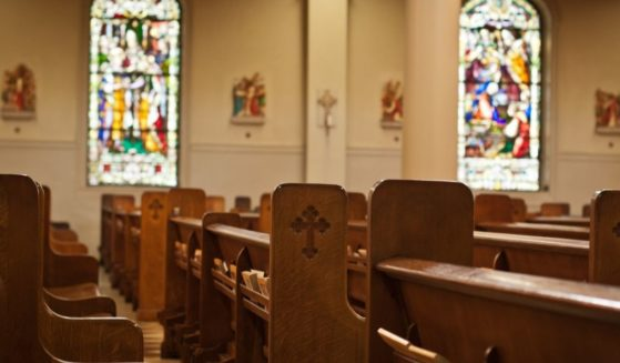 The inside of a church is seen in this stock image.
