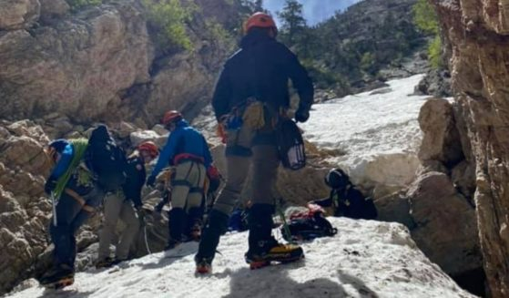 The Salt Lake County Sheriff's Office Search and Rescue team retrieves the body of a climber who died after falling around 100 feet on Mount Olympus.