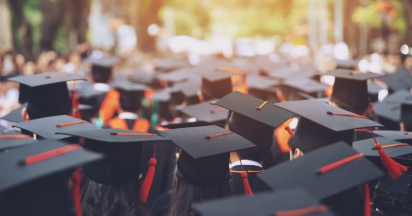 College graduates are seen in this stock image.
