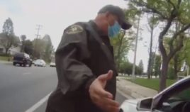 A Los Angeles County Sheriff's Office supervisor talks to a motorist during a traffic stop recorded on a deputy's personal body camera.