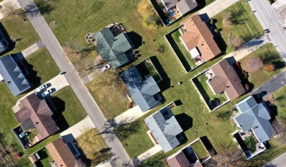 This stock image shows an overhead view of a block of houses.