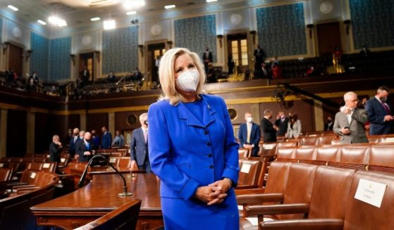 Rep. Liz Cheney waits for the arrival of President Joe Biden before he addresses a joint session of Congress at the U.S. Capitol in Washington, D.C., on April 28, 2021.