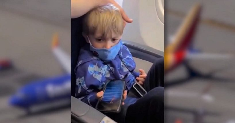 Orion Scott, 3, wears a face mask aboard his family's plane.