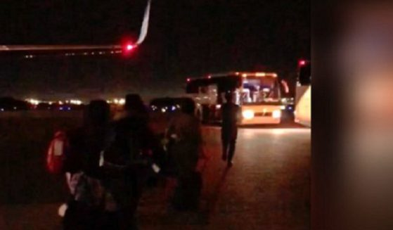 A bus is loaded with apparently illegal immigrant children during a night operation at McGhee Tyson Airport in Knoxville, Tennessee.