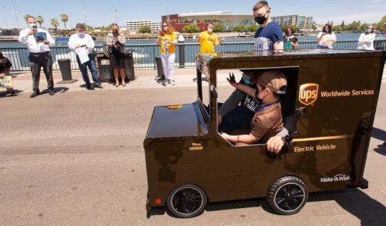Six-year-old Mateo Toscano drives his mini UPS truck.