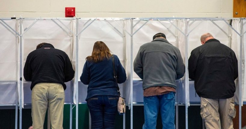Voters fill out their ballots at the Captain Samuel Douglass Academy in Brookline, New Hampshire, on Nov. 3, 2020.