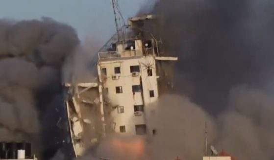 Al Sharuk tower collapses after an Israeli airstrike on Wednesday.