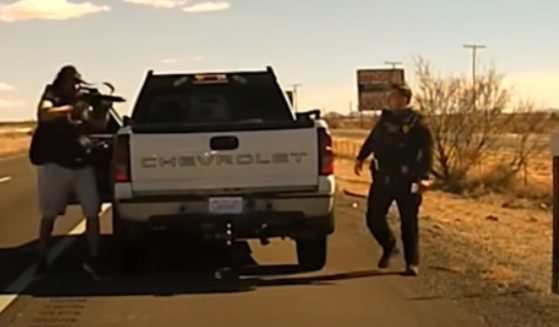 A suspect fires on a New Mexico State Police officer.