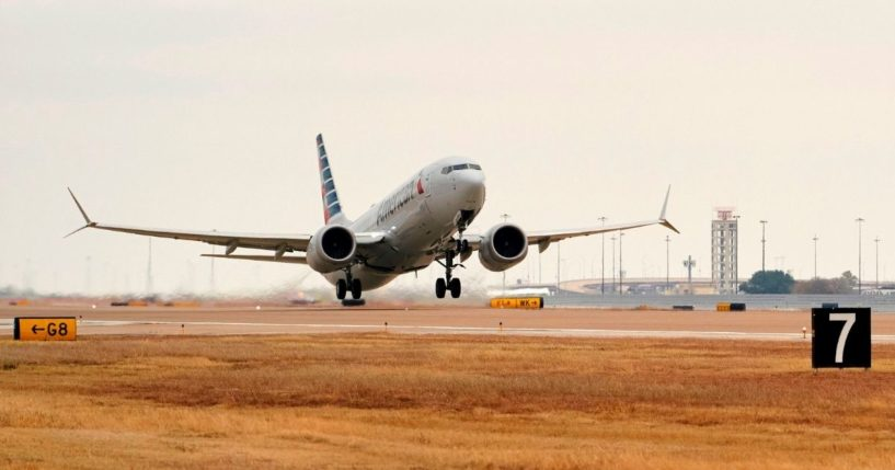 An American Airlines Boeing 737 MAX airplane takes off on a test flight from Dallas-Fort Worth International Airport in Dallas, Texas, on Dec. 2, 2020.