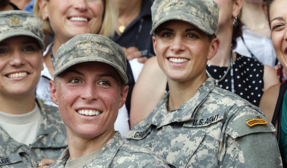 In this Aug. 21, 2015, file photo, Army 1st Lt. Shaye Haver, center, and Capt. Kristen Griest, right, pose for photos with other female West Point alumni after an Army Ranger school graduation ceremony at Fort Benning, Georgia. Haver and Griest became the first female graduates of the Army's rigorous Ranger School.