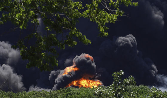 Flames and smoke are seen from an explosion at a chemical plant in Rockton, Illinois, on Monday.
