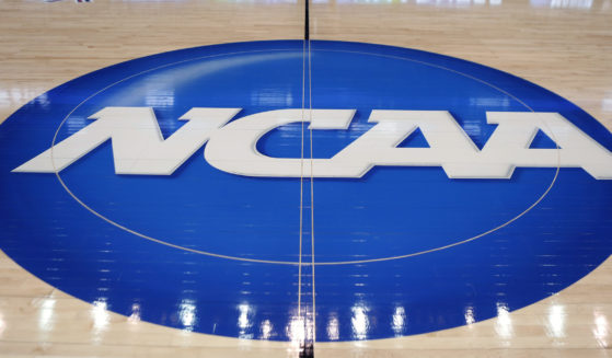 In this March 18, 2015, file photo, the NCAA logo is displayed at center court as work continues at The Consol Energy Center in Pittsburgh, for the NCAA college basketball tournament.
