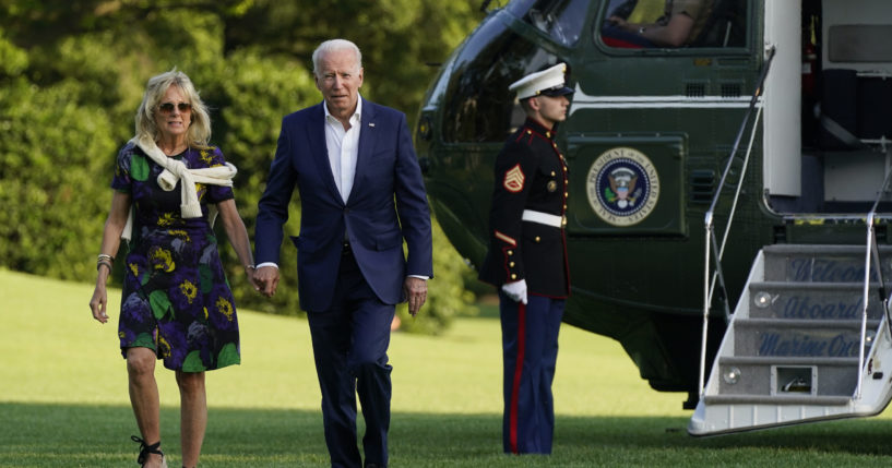 President Joe Biden and first lady Jill Biden walk on the South Lawn of the White House after stepping off Marine One on Sunday in Washington.