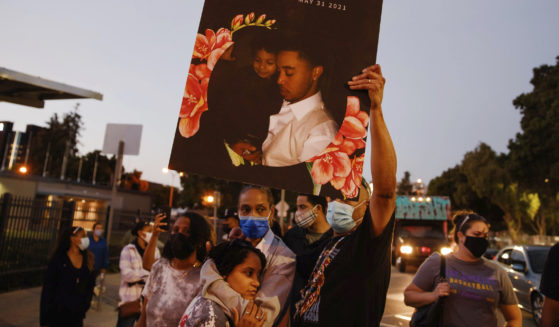 A sign with a picture of Demetrius Stanley on it is held up during a protest in San Jose, California, on Tuesday.