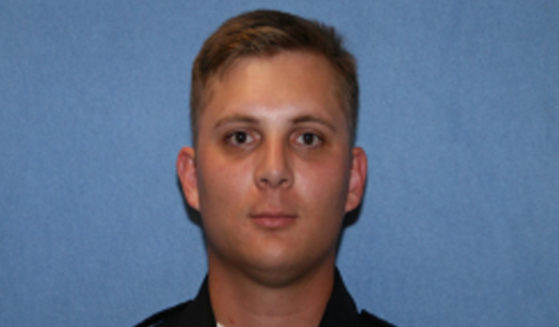 This undated photo shows Phoenix police officer Ginarro New. New died after being hit by a driver who ran a red light and also died, authorities said Tuesday.
