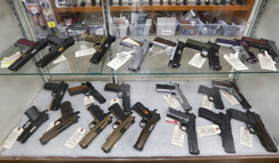 Semi-automatic handguns are displayed at a shop in New Castle, Pennsylvania, on March 25, 2020.