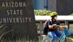 A cyclist crosses an intersection on the campus of Arizona State University on Sept. 1, 2020, in Tempe, Arizona.