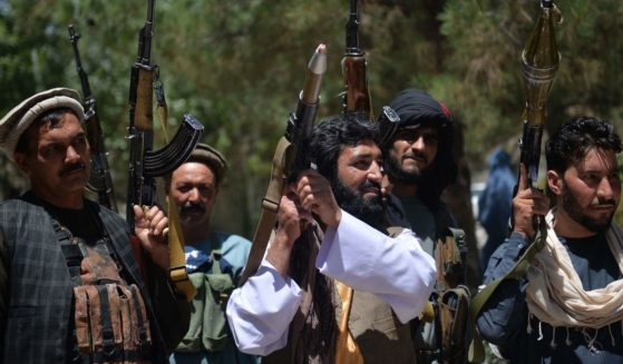 People gather to support Afghan security forces against the Taliban in Guzara district, Herat province on Wednesday.