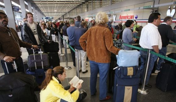 Passengers wait in line to check in for American Airlines flights at O'Hare Airport on April 9, 2008, in Chicago, Illinois.