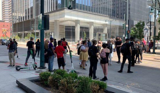 Antifa crowding around on California St. in downtown Denver.