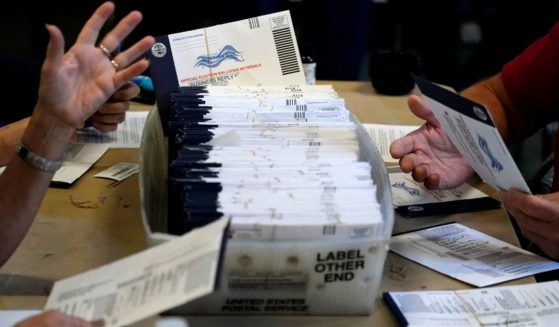 In this Nov. 4, 2020, file photo, Chester County election workers process mail-in and absentee ballots for the 2020 general election in the United States at West Chester University in West Chester, Pennsylvania.
