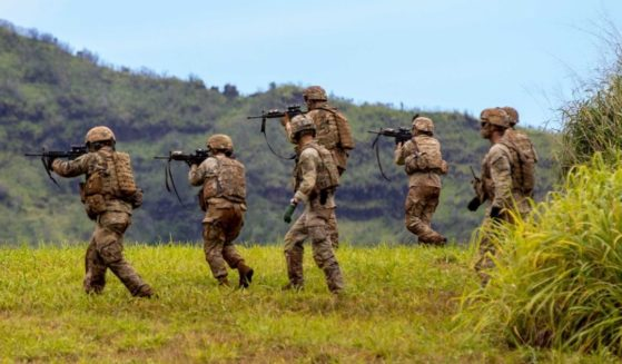 Soldiers assigned to A Company, 29th Brigade Engineer Battalion, 3rd Infantry Brigade Combat Team, 25th Infantry Division conduct squad live fire exercise training at Schofield Barracks in Hawaii on March 30.