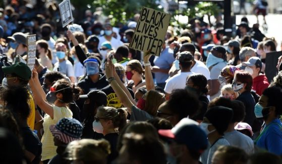 """A person holds a """"Black Lives Matter"""" during a demonstration near the White House in Washington on June 1, 2020."""