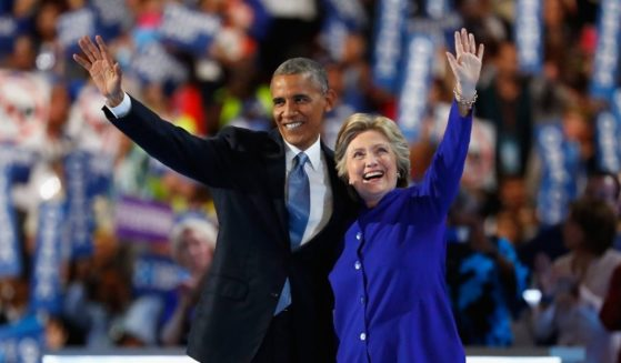 Then-President Barack Obama and then-Democratic presidential nominee Hillary Clinton acknowledge the crowd on the third day of the Democratic National Convention at the Wells Fargo Center in Philadelphia on July 27, 2016.