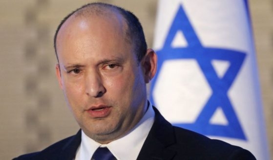 Israeli Prime Minister Naftali Bennett speaks during a memorial service at the Mount Herzel military cemetery in Jerusalem on Sunday commemorating soldiers who died in the 2014 Gaza war.