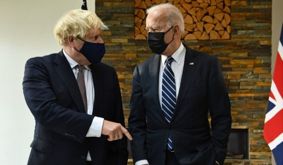 Britain's Prime Minister Boris Johnson, left, and U.S. President Joe Biden view a display of documents relating to the original Atlantic Charter ahead of their meeting at Carbis Bay, Cornwall, on Thursday, ahead of the three-day G7 summit.