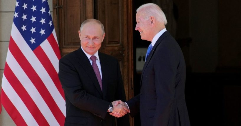 Russian President Vladimir Putin, left, shakes hands with U.S. President Joe Biden during their meeting at the Villa la Grange in Geneva on Wednesday.