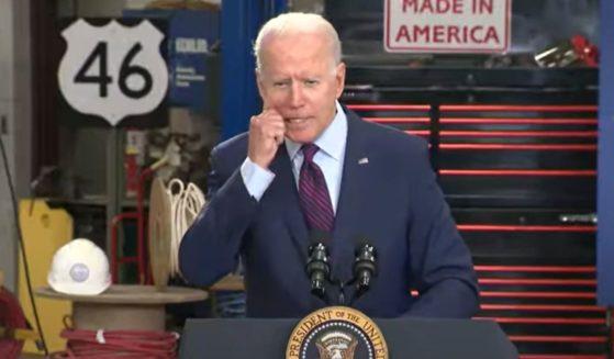 President Joe Biden grabs his cheek during an infrastructure speech at the La Crosse Municipal Transit Utility inWisconsin on Tuesday.