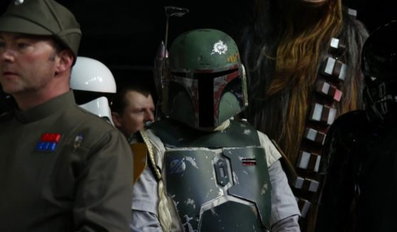 """An actor dressed as Boba Fett arrives at the European premiere of the film """"Star Wars: The Force Awakens"""" in London on Dec. 16, 2015."""